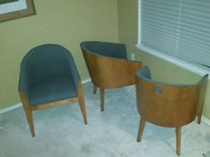 3 contemporary European Teak Captain's Chairs in Seattle, WA (sells for $220)