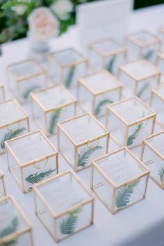 "From the editorial ""A Ballroom Reception Done Oh So Right at the Rosewood Miramar Beach."" If you're looking for creative reception ideas, look no further! This escort card display is not only unique but absolutely stunning! LBB Photographer: @josevilla #escortcarddisplay #weddingseatingchart #weddingreceptionideas #uniqueweddingideas"