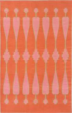 Love this area rug by Madeleine Weinrib. A background of tangerine is offset by pops of pink and olive green.