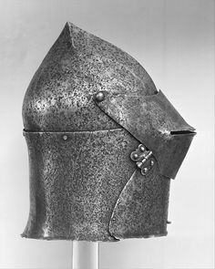 Visored Bascinet Date: ca. 1425–50 Culture: Italian Medium: Steel Dimensions: H. 13 3/8 in. (34 cm); W. 8 1/2 in. (21.6 cm); D. 9 1/4 in. (23.5 cm); Wt. 8 lb. 10 oz. (3912 g)