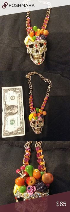 Betsey Johnson fruit sugar skull necklace Enamel fruit and jewel-encrusted skull.  Hot pink gems inter woven in gold tone chain. Worn once. Excellent condition. Betsey Johnson Jewelry