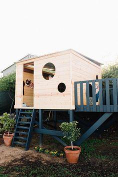 Modern backyard playhouse design deck