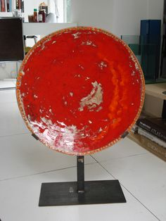 Red & orange  enamel fired at 800º on plate with iron structure.
