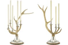 Channing Stag triple and five-light candelabra by Ralph Lauren Home, featuring naturally shed antlers atop an oak-and-silver base, $2,995 and $3,495, respectively.