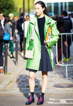 Sunghee Kim in a lime green parka + striped flared skirt