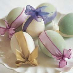 How pretty, soft pastel Easter eggs tied up in transparent ribbons.  Seasons @4seasons-blog.tumblr.com