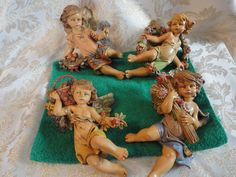 """Fontanini Depose Italy Early Set of Four Seasons Cherubs"""" Nativity Angels - These Adorable Cherubs are the Four Seasons Pedestal Cherubs. Winter Holds a Basket of Winter Fruit Nestled in Holly Leaves. Fontanini Nativity, Holly Leaf, Cherubs, Four Seasons, Princess Zelda, Seasons Of The Year"""