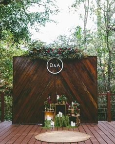 Amazing #darkwood #backdrop highlights the #setup #monogram! Photo via #theweddingplaybook
