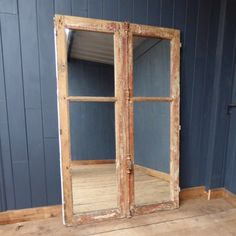 Mirrored reclaimed French chateau doors.  This fabulous large mirror has been created using a pair of reclaimed French chateau doors as the frame, complete with original metal handle and fixings.  This impressive piece is full of character and would make a lovely addition to any room.  #cheshire #reclamation #salvage #antiques #collectables #vintage #retro #home #garden #design #interiordesign #furniture #antique #design #reclaimed #rustic #industrial