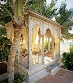 Moroccan Inspired pool cabana with draperies to cover it