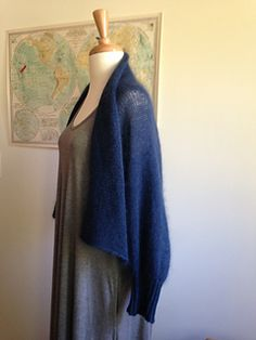 """This airy layering piece combines two of my favorite """"clouds"""": Shibui Silk Cloud and Lotus Tibetan Cloud. The two yarns together knit up into a fabric that is so very soft, warm and lightweight. Front edges and collar are left to drape elegantly, or can be crossed over and fastened with a shawl pin for maximum warmth. Top your best frock on a chilly evening, or throw it on instead of a sweatshirt for effortless weekend style!"""