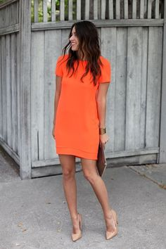 Shop this look on Lookastic: https://ca.lookastic.com/women/looks/orange-shift-dress-tan-pumps-brown-clutch-gold-bracelet/12498   — Orange Shift Dress  — Gold Bracelet  — Brown Leather Clutch  — Tan Leather Pumps