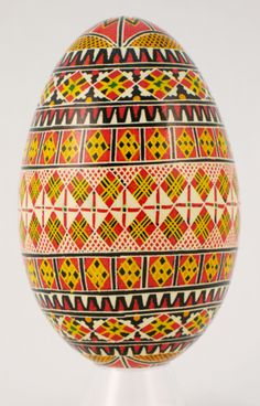 Ukrainian goose Pysanka with diamond, cross and triangle motifs. Triangles are the sign of the Trinity, crosses symbolize Christianity, and diamonds signify knowledge and immortality