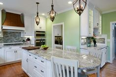 Fetching Three Vintage Chandelier Pendant Lights Over Kitchen Island Inspiration in Light Green Kitchen Decoration Features Marble Ship Shaped Kitchen Island also White Finish Seatings. #Netnoot #IslandLighting #KitchenLighting