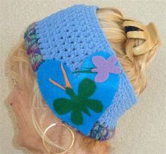 Colorado clothing. So unique and beautiful...its a great headband for someone who loves the color blue. The Maya blue is in soft polyester suede yarn and the bottom row is wool in shades of fuchsia, mint green, deep purple and gray. The attached felt heart is in royal blue, forest green and lilac. The felt heart brooch is attached with pins secured with felt and can be easily removed. This is made for the young or young at heart. The butterflies are in the style of Andy Warhol. This really…
