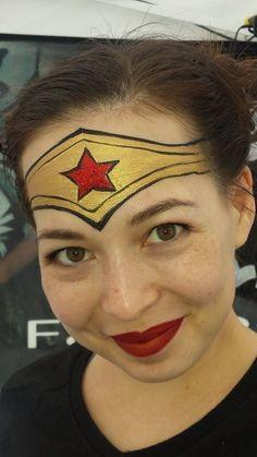 Super cool and easy Wonder Woman by the amazing Mark Reid! Tiana Tong is the beautiful model www.sillyfarm.com #faceart #facepainting #facepainters #wonderwoman
