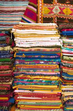 In Morocco, traditional shops line the streets selling fabrics that are infused with colors, prints, and patterns