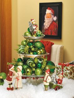 I think using a tiered dessert plate with glass balls makes such an easy, great table top Christmas tree!