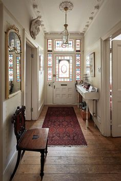 The entry in a Victorian townhouse in Southwest London features decorative origi. - The entry in a Victorian townhouse in Southwest London features decorative original stained glass w - Victorian Hallway, Victorian Townhouse, Victorian Home Decor, Victorian House London, Victorian Windows, London House, Victorian Era, Modern Victorian Bedroom, Victorian Rugs