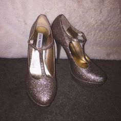 Goldish Silver Steve Madden Heels Goldish Silver Steve Madden glitter heels with straps. Only worn once with small, barely visible scuffs on bottoms. Steve Madden Shoes Heels