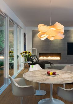 Home design by Carnemark in Potomac, Maryland USA. The home features a Link pendant lamp by Ray Powers and produced by LZF Lamps
