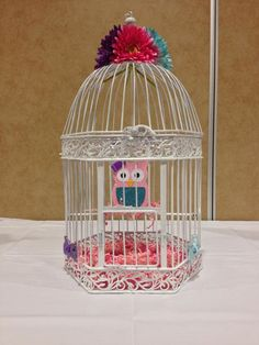 Baby Owl in a bird Cage for an #Owl #Baby #Shower. Click to see more Owl Baby Shower Ideas at this party.