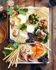 10 Fast and Easy Appetizers for Thanksgiving via @MyDomaine If you don't have time to cook, assemble a pretty cheese board with nuts, fruit, honey, olives, and crackers.