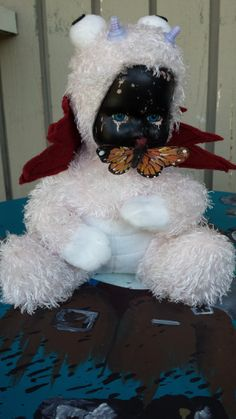 Monster Porcelain Doll with butterfly by ZeeesCloset on Etsy, $15.00