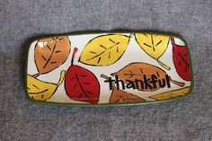 fall leaves designed pottery thankful rectangle plate thanksgiving harvest red brown and yellow Pottery Painting, Ceramic Painting, Diy Painting, Painted Pottery, Rock Painting, Painted Plates, Hand Painted Ceramics, Ceramic Plates, Thanksgiving Plates