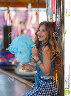 Photo about Happy teen at fair eating candy floss or cotton. Image of friendship, carnival, entertainment - 53400789 Happy Teens, Blue Cotton Candy, Candy Floss, Carnival, Tulle, Stock Photos, Eat, Friendship, Image