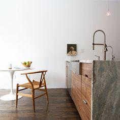 A minimalist, angular kitchen.