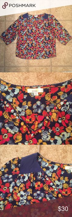 Anthropologie silk floral top Such a pretty little top for warm weather. Darling with jeans, white denim, or shorts. Tiny covered buttons line the v-neck. Classic Anthro! Excellent condition. Anthropologie Tops Blouses