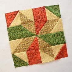 Inspired by Fabric: Silent Night Sampler: Day 10-Today is Star Block #3. We call it a star block, but we also think it also looks like the bow on a present from the top view.