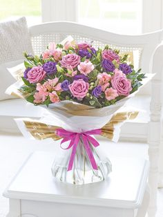 This elegant bouquet is a delightful choice for someone special.