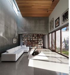 Living room; industrial, glass, concrete, wood, books,