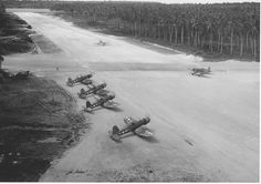 F4U Corsair aircraft of VMF-222 on the ground ready to taxi onto the runway for launch from Russell Islands 1944
