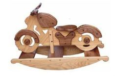 Amish Oak and Walnut Wood Kids Motorcycle Rocker Exquisite solid wood motorcycle rocker makes for one fine ride! A popular pick for the playroom. Crafted by hand with solid wood. #woodtoys #kidsglider