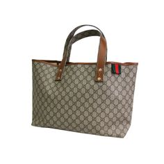 This authentic GUCCI Tote Bag is made from brown and beige GG canvas. Find  similar luxurious items at www.swayy.com.au 0d77f9bd01