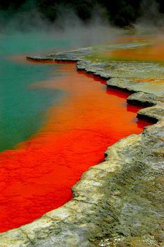 Waiotapu Thermal Reserve, Rotorua, New Zealand. The orange-red color is caused by the minerals orpiment and realgar