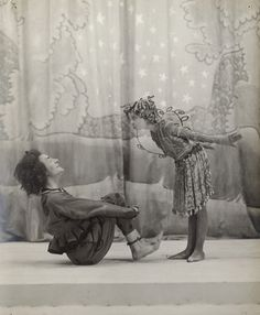 Oberon & Puck from A Granville-Barker's Midsummer Night's Dream. His production of A MNDream was perhaps the most influential, with a small cast, spare staging & golden, slightly sinister fairies based on Asian idols. Here we see George Burrows as Oberon & Donald Calthrop as Puck.