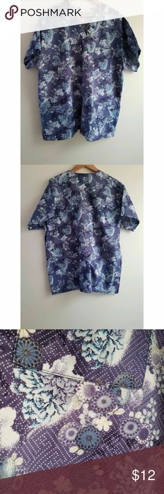 """Peaches Blue White Scrub Top Peaches Uniforms Blue Floral Multi-color 100% Cotton. V neck. Side vents. Three front patch pockets. Chest/Bust 23"""" . Length 17"""" from arm pit. Peaches Tops"""