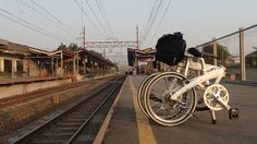 Dahon MU P8 with front carrier block and Brompton S bag