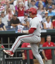 Indiana's Kyle Schwarber celebrates after scoring Indiana's first run in the first inning against Louisville in Saturday's second College World Series game in Omaha. (By Matt Stone, The Courier-Journal) June 15, 2013