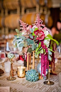 Lauren Sharon Vintage Rentals & Design: Centerpieces w/ Seven Stems Floral Design and True Photography Weddings via CeremonyBlog.com  Eclectic centerpieces, gold, brass and glass with succulents and gorgeous marsala and green florals.