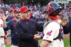 Manager Terry Francona gives congrats to catcher Roberto Perez after the Indians beat the Boston Red Sox 3-1 on October 4, 2015 at Progressive Field.  The Indians finished with a 81-80 record for the year.  Behind Francona is pitching coach Mickey Callaway.  (Chuck Crow/The Plain Dealer)