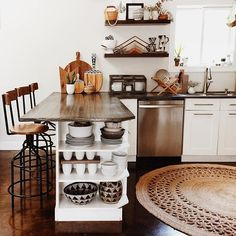 Some great ideas for saving costs with renovating your kitchen. Open shelving in place of upper cabinets and around a kitchen island will save you major bucks., and you get to display all your cute dishes!