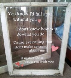 DIY song lyrics on old window pane. Might just put our names outside of reception barn.