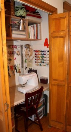 Great small craft closet space! This lovely sewing closet uses every inch wisely!