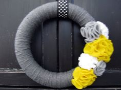 Yellow and gray yarn wreath...I'm eventually going to make one of these wreaths that I pin up here one day!