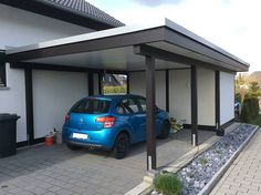 Simple carport that could work. Also loving the rocks - Liz